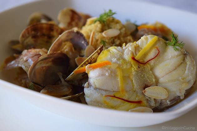 cous cous con rana pescatrice, agrumi e mandorle