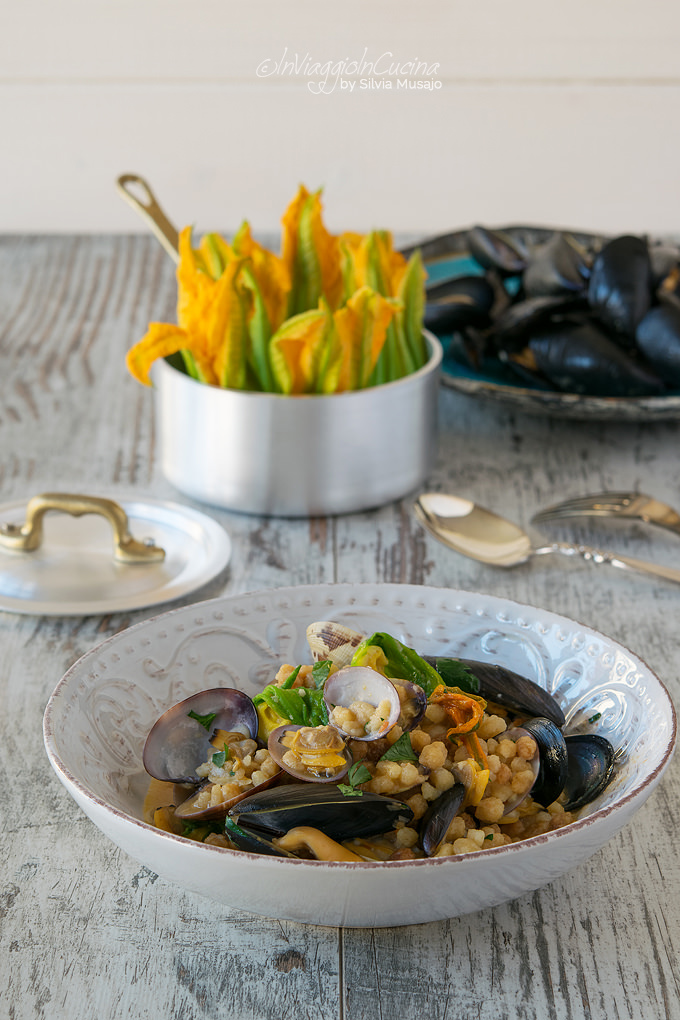 Fregola pasta with courgette flowers mussels and clams
