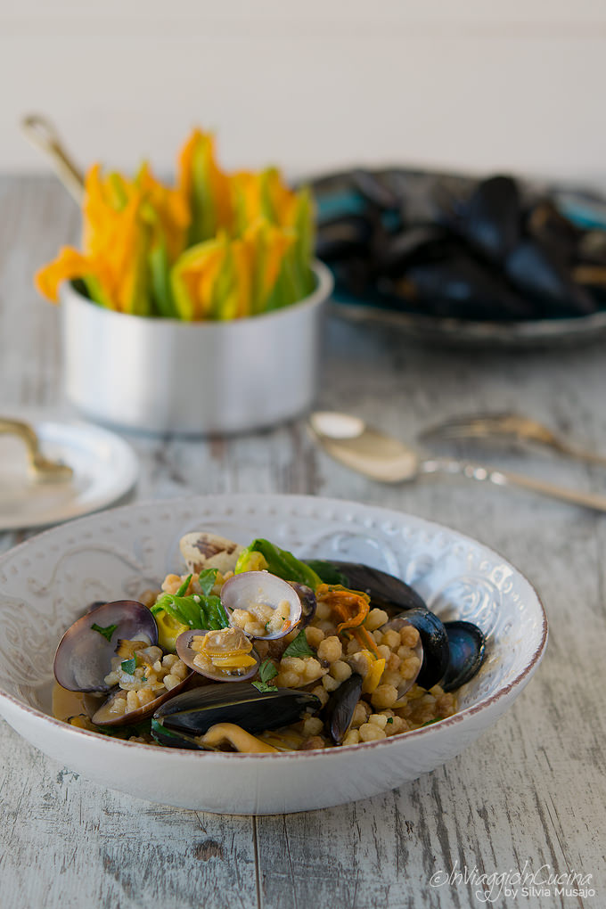 Fregola pasta with courgette flowers