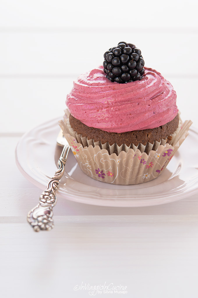 chocolate cupcake with blackberry and cream cheese topping