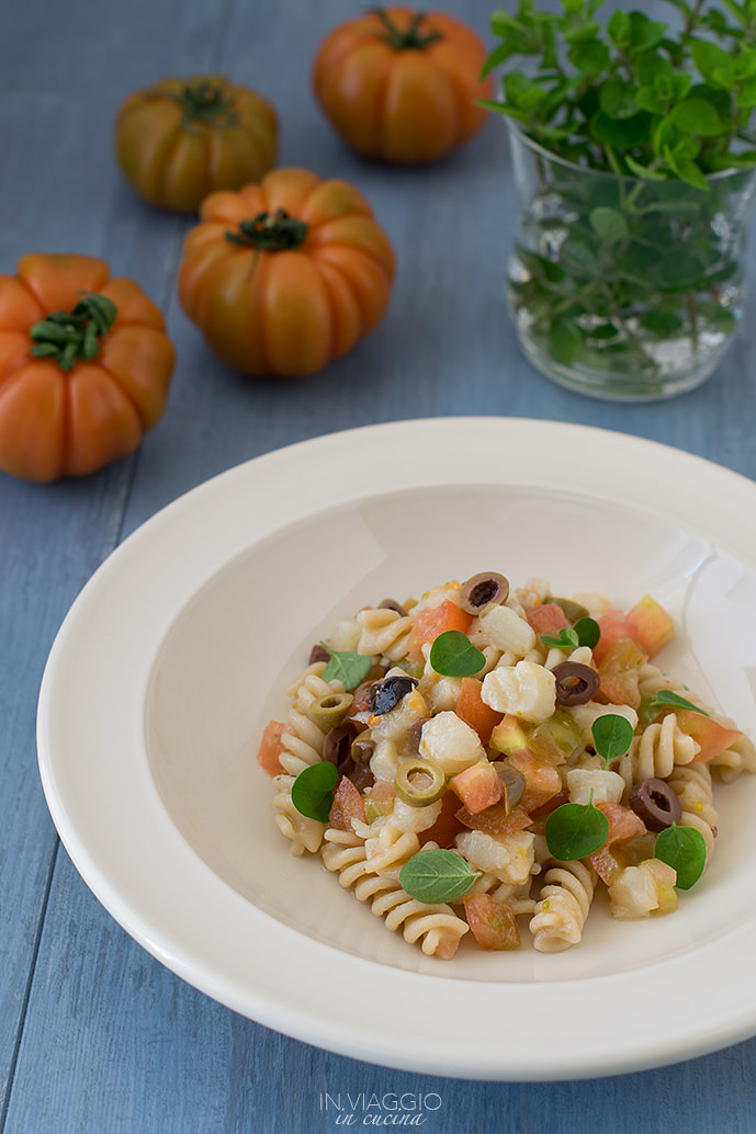Pasta salad with tomatoes, olives and white fish