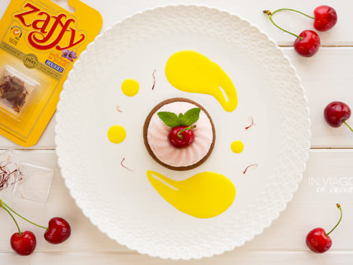 Cherry mousse on sablé cocoa biscuit with saffron sauce