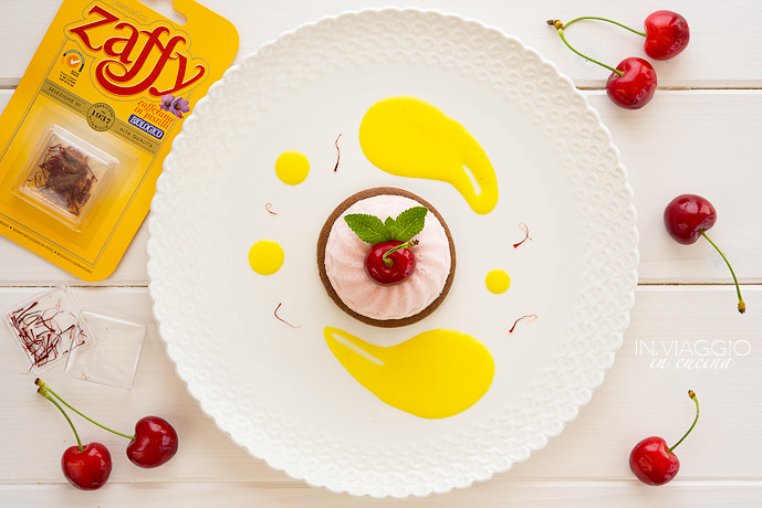 Cherry mousse on sablé cocoa biscuit with saffron sauce
