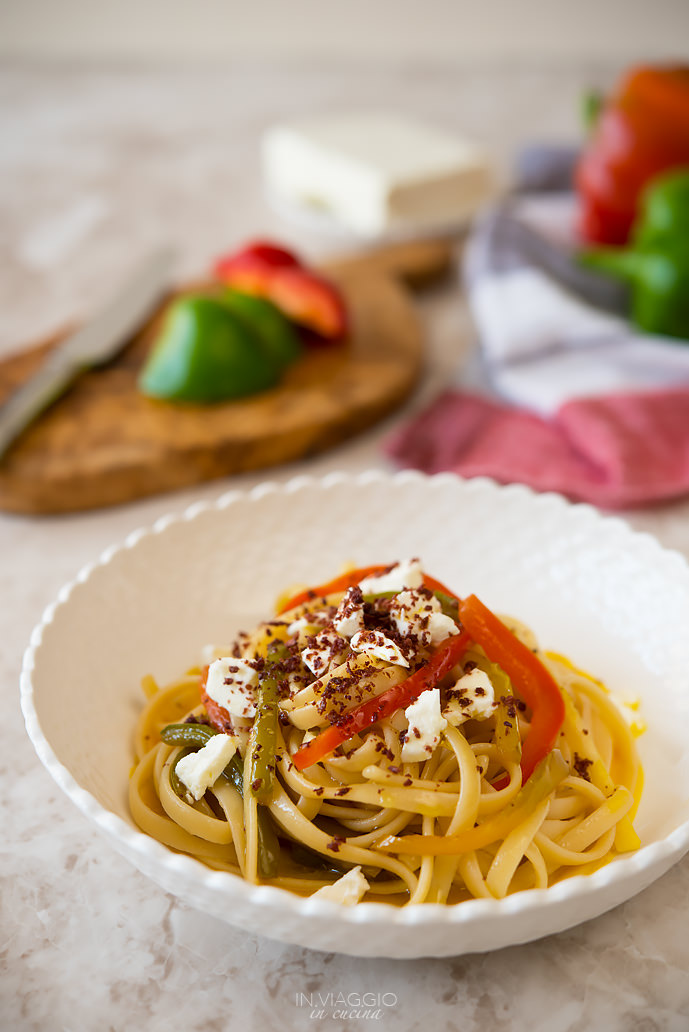 Linguine with dual texture pepper, feta cheese and olive powder