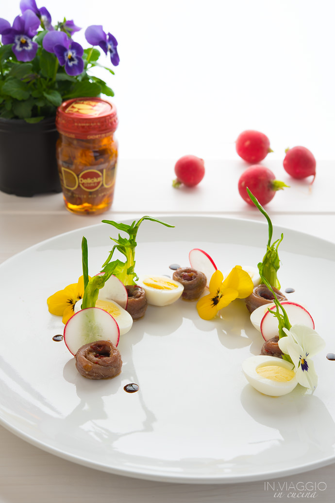 Salad with quail eggs and anchovies