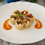 Cold pasta stuffed with ratatouille with red bell pepper sauce